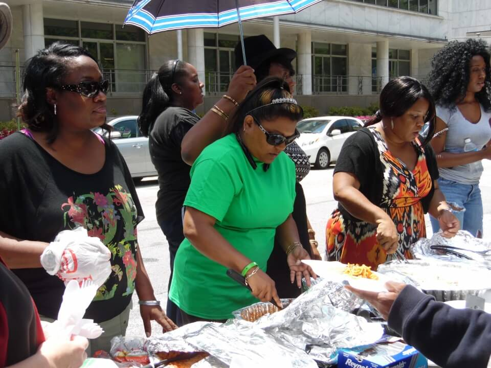 Dr. Angie Eugene is serving a meal to member of the homeless community in Atlanta, GA